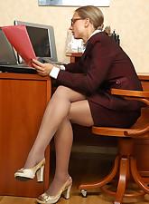 Lusty secretary in sheer pantyhose getting kicks from lesbian games at work