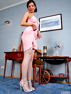 Leggy brunette looks hot in her sheer white stockings and little pink dress