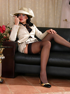 Awesome chick in fancy stockings willingly finger-fucking her muff close-up
