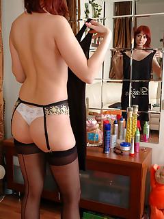Redhead chick choosing a lovely dress for her elegant back seam stockings