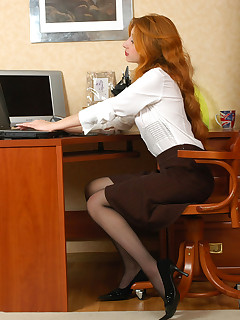 Red-haired office girl lets her dildo toy feel the silkiness of her nylons