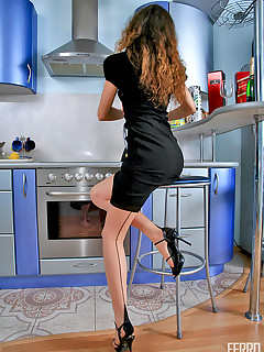 Cutie in natural with black contrast seam spreading her legs in the kitchen