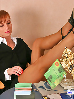 Redhead secretary hotly caressing her pantyhosed pussy with manicured hands