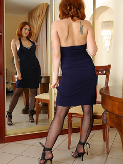 Red-haired chick in black seamed suspender hose stuffing her favourite toy