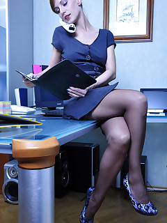 Leggy office babe strips to her gartered stockings and uses her giant dildo