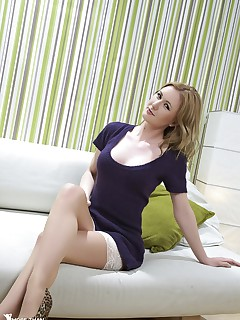 Beuautiful leggy woman Sam Tye in sexy white stockings and high heels