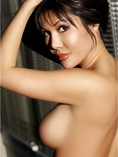 Jeannie Kim is a rare Asian beauty and is happy to show off for you in her sheer black bra and panties.