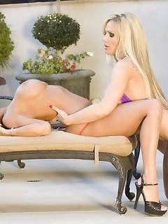 Beautiful busty pornstar, Tyler Faith, gets a taste of Lexxi Tyler as the two take off their sexy bikinis by the pool.