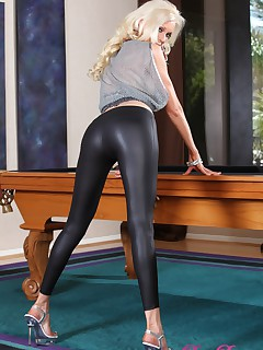 Demi Dantric shows off her sexy legs in her tight leather pants, strips them off for some fun on the pooltable.