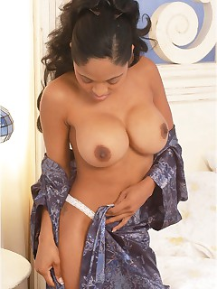 An ebony goddess, Chea Tennille looks fantastic lounging in bed waiting for someone to help her out and have a good time.