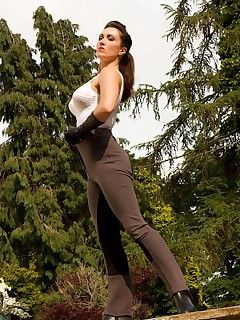 Miss Hybrid wearing jodhpurs, boots and gloves