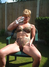 Horny MILF getting naked and..