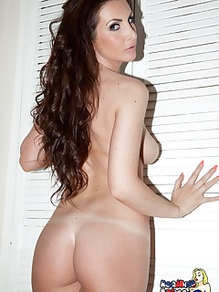 Amy Alexandra strips naked from her gold bra and thong