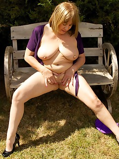 Hi Guys in the Garden again in my Purple Hotpants and short tie top but it was such a lovely day I just had to strip..