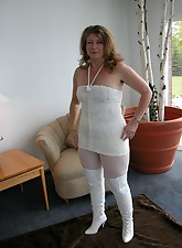 Devlynn shows a change of pace here with an all white Snow Princess look White furry dress white pantyhose paired with..