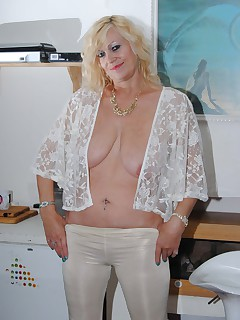 Wearing white trousers and a see thru white top start my flashing while wearing a bra then remove it to flash her..