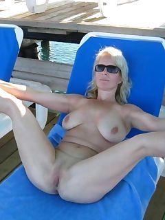 Hardcore blonde housewife posing naked and spreading.. Housewife posing naked outdoors for her lover
