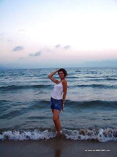 MILF teasing lover by the beach while posing braless under.. MILF braless under a see-thru top